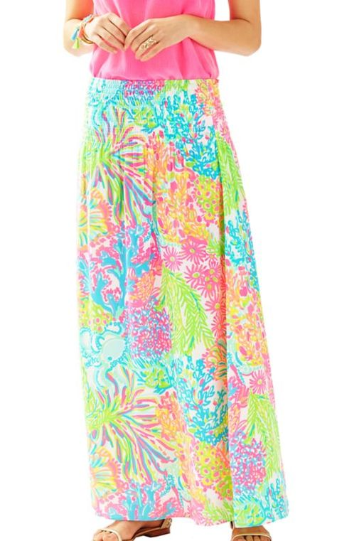 da2ab6581787 The Bohdi Maxi Skirt is a smocked waistband maxi skirt in island satin.  This skirt pairs beautifully with a white silk top and wedges for a  celebration or ...