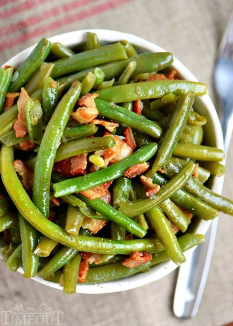 My Nana's Famous Green Bean recipe! Made with just a handful of ingredients including bacon, this easy green bean recipe make a delicious addition to any meal! One of the most requested recipes from my family - year-round!// Mom On Timeout #greenbeans #greenbeanrecipe #green #beans #bacon #onion #sidedish #greenbeans #veggies #easy #recipe #momontimeout