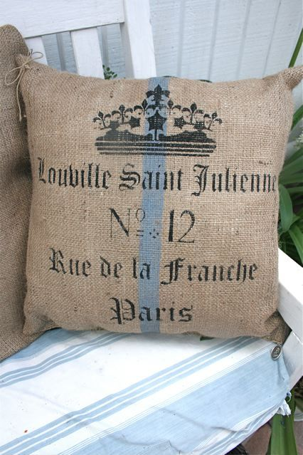 Pillow made from very inexpensive burlap decorated with stencils.