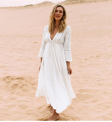 295de1e15672e A sheer all white dress featuring a plunging v-neckline, three fourth  sleeves laced design and soft flowy skirt. - Material: Rayon and Polyester  - Length: ...
