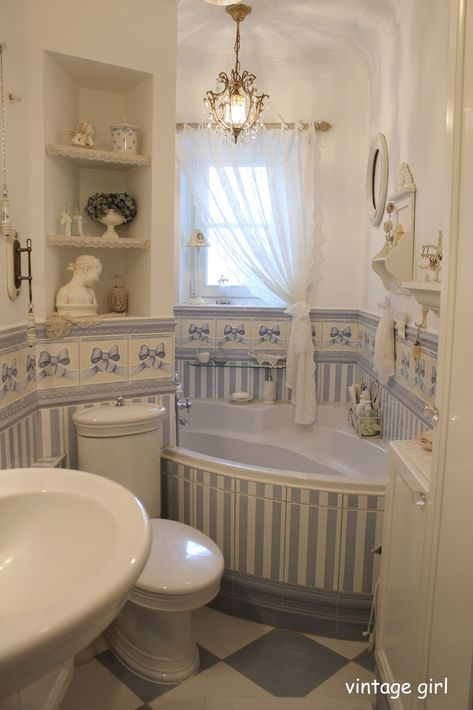 Tiny and a bit overkill with all the ribbons, but cute, and I really like this toilet...