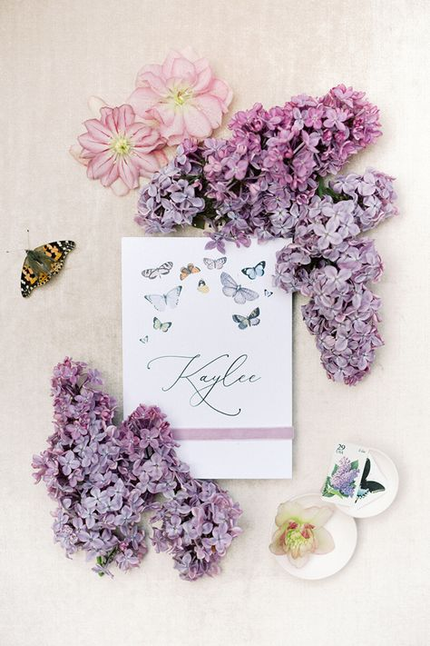 From the editorial A Breathtaking Garden Wedding Inspired by a Butterfly  Floral Monique Lhuillier Gown. These wedding invites included lilacs and butterflies and were designed by the bride's Maid of Honor!  Photography: @lunademarephoto Paper Goods: @sarah_stimpson  #weddinginvitations #weddinginvitationsuite #lilacs #gardenwedding