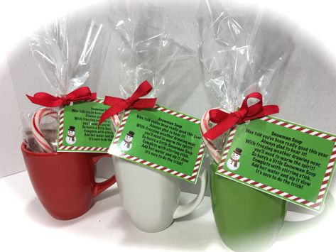 Snowman Soup Christmas Mugs! This complete Snowman Soup Gift Set is filled with mini marshmallows, milk chocolate hot cocoa mix, and a candy cane in a 12 oz mug. A cute Snowman tag is added with the poem: Was told youve been really good this year Always glad to hear it! With