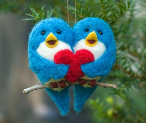 Two blue birds, perched on a wee branch, holding a heart and each other. Birds measure about 3 inches tall and both together are about 3 inches wide. All parts are carefully sculpted using wool. A perfect gift for Valentines Day. Bird couple you receive may vary slightly from the ones pictured, but