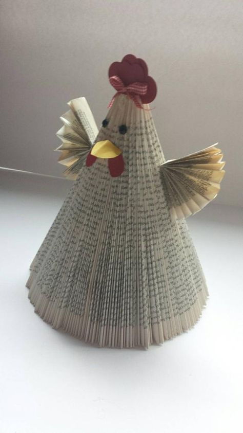 This chicken/rooster is made from a repurposed book. Embellished with hearts and fan folded wings. Eyes are black rhinestones. .