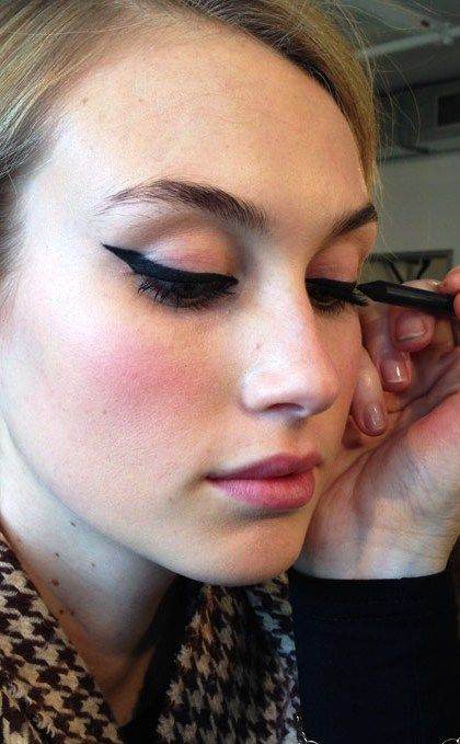 Tip: Draw a dot on the outer corner. Then, draw a line to the lash line. Creates the perfect triangle every time!
