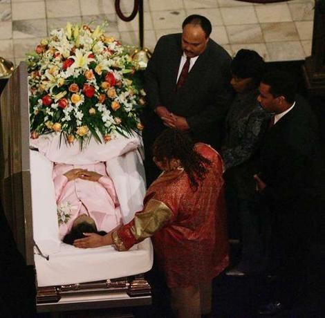 Fond farewell: elder daughter Yolanda King leans over to touch the head of her mother, Coretta Scott King