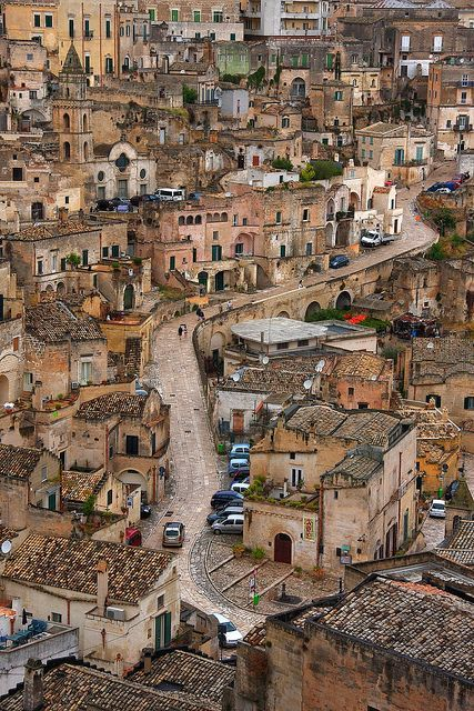 "The crowded setting of the Matera city, in Italy. Around since  the Palaeolithic times, its ancient old town center, the ""Sassi di Matera"" (meaning ""stones of Matera""), are thought to be among the first ever human settlements in what is now Italy."