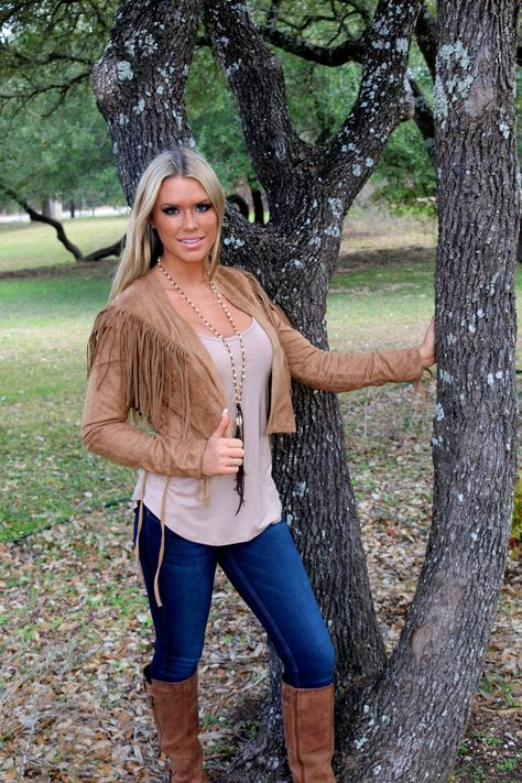 Rodeo Ready jacket is a soft faux suede in a camel color. Features fringe yoke on the back that wraps around to the front shoulders and lace up fringe ties at the sleeves and hips that you can tie into a bow. Shown with our Basic Modal tank in Mocha.