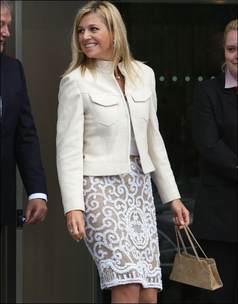 Love her outfit. Love the straight lining of her jacket. This matches her bone structure. The length of her skirt is perfectly right. She needs some cool bright lipstick.