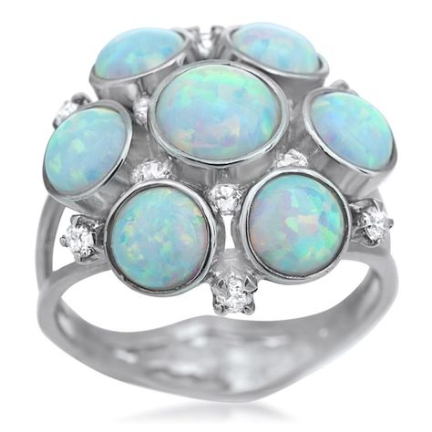 Shimmering, iridescent created opal stones cluster in perfect radial symmetry. The cubic zirconia accents only add to the bright beauty of this silver set.