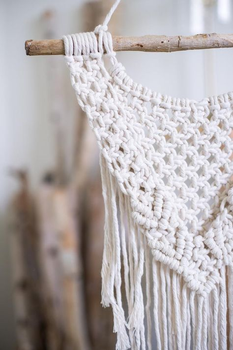 This macrame wall hanging is made from 100% cotton string and attached to re-purposed wood. Perfect for your office, nursery, dorm room, or gallery wall.