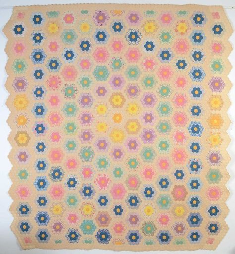 """Grandmother's Flower Garden Quilt: Circa  1930. Organized, symmetrical use of color as well as the small size of the gardens. In addition, it is done on an ecru ground, rather than the more usual white. Measurements are 86"""" x 96"""""""