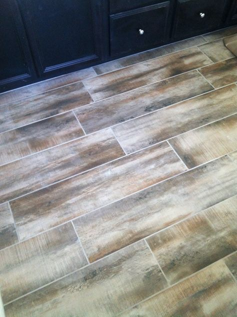 Wood tile in our bathrooms and laundry roon! Antique Amaretto