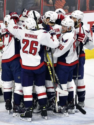 The Washington Capitals celebrate after advancing