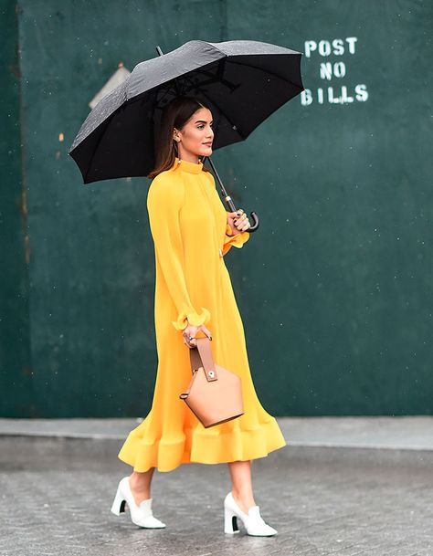 Camila Coelho is seen wearing a Tibi dress and a Danse Lente bag outside the Tibi show during New York Fashion Week: Women's A/W 2018 on February 2018 in New York City.