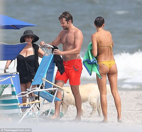 It's a family affair: Gloria and Irina seemed to get on like a house on fire as they chatted on the beach