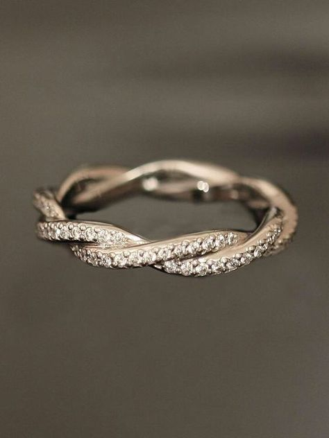 Pretty. 10-year anniversary band, perhaps?  Or if he really couldn't afford a ring… Although I'm sure he's been saving up!