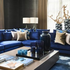 Luxurious High End Lounge With Royal Blue Sofas And Textured Wall Coverings Blue And Gold Living Room Gold Living Room Blue And Gold Bedroom