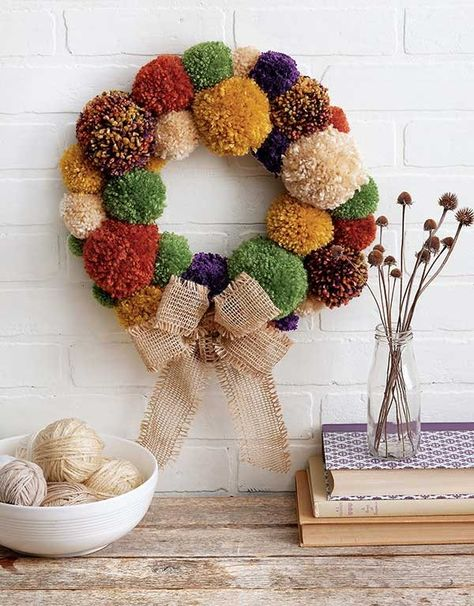 Yarn Crafts – Plush, colorful yarn is the perfect accent for creative crafting! … Yarn Crafts – Plush, colorful yarn is the perfect accent for creative crafting! Yarn Crafts from Leisure Arts shows how to wrap it around bottles or… Continue Reading → Diy Yarn Wreath, Pom Pom Wreath, Pom Poms, Yarn Wreaths, Diy Yarn Decor, Halloween Yarn Wreath, Pom Pom Flowers, Felt Flower Wreaths, Yarn Flowers