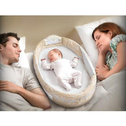 baby sleeping in bed with parents