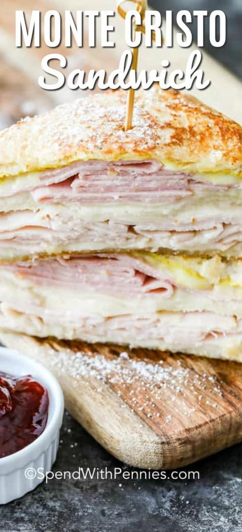 This Monte Cristo recipe uses white bread, ham, turkey, and swiss cheese. These ingredients are layered, dipped in an egg mixture, then fried and dusted with powdered sugar! To finish this dish off, I serve it with a side of strawberry jam. #spendwithpennies #montecristo #lunch #sandwich #grilledcheese #croque-monsieur