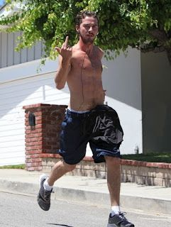 Shia LeBeouf giving the Finger while jogging