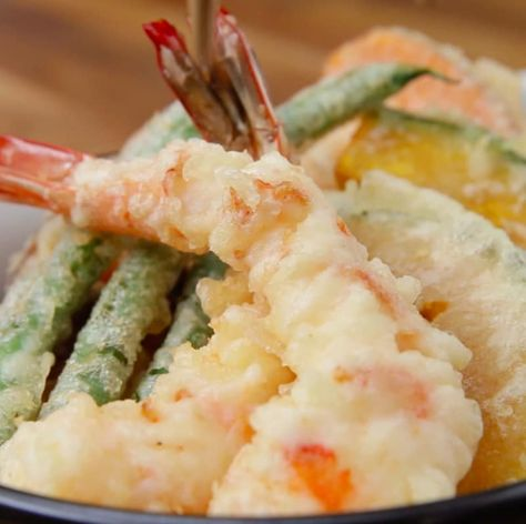 Servings: 2INGREDIENTS4 shrimpSweet potatoMushroomsGreen beans Kabocha pumpkinRiceTempura batter:1 egg½ cup soda water, cold½ cup cake flourOil for fryingDipping sauce:1 tablespoon soy sauce1 tablespoon mirinOptional: ¼ cup hot water1 teaspoon dashi granules (Japanese stock granules)PREPARATION1. Prepare shrimp by taking off shell and deveining. 2. Make 4 slits down the stomach. Flip shrimp on the side and diagonally slice 4 more slits on each side. (This will keep the shrimp straight when co...