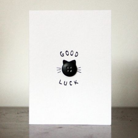 Hand-made good luck card with a single black button.