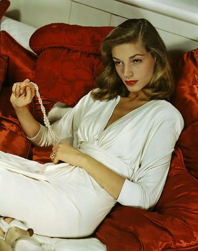 Lauren Bacall's side part, red lips and amazing arched brows make me wonder where has all the glamour gone?
