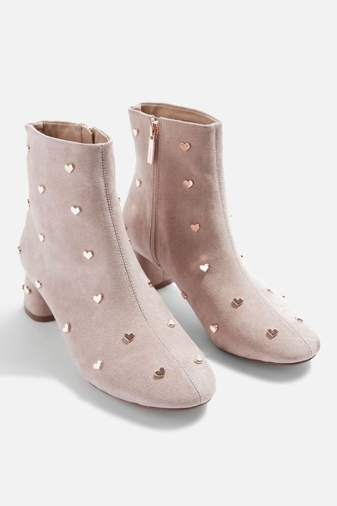In a pretty shade of Taupe, these elegant ankle boots have been speckled with charming heart studs. Featuring a mid heel and side zip fastening, they'll put a spring into your step.