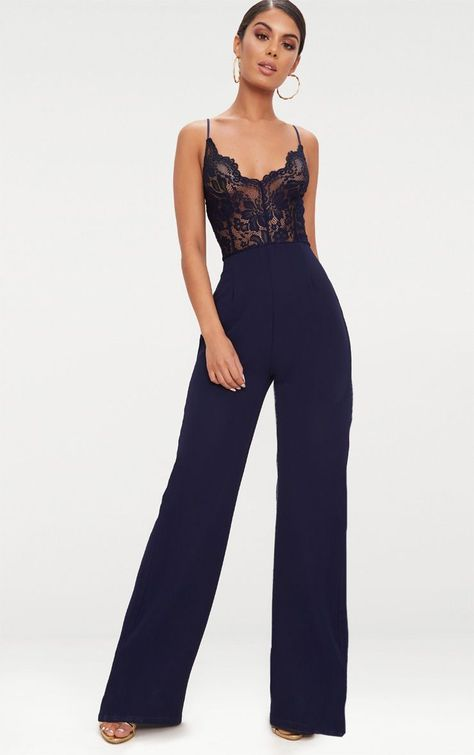 Navy Lace Wide Leg JumpsuitTurn heads in this fierce jumpsuit. Featuring a lace top and contrasti.