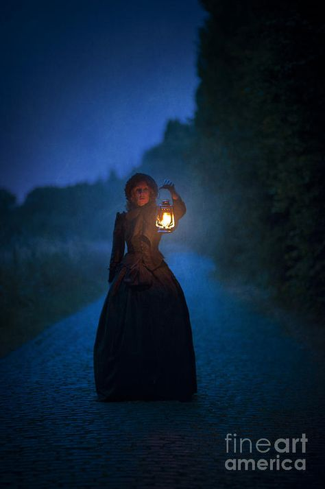 Victorian Woman Holding A Lantern At Night by Lee Avison