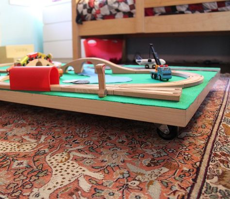 DIY under bed train table - my kids seriously need this to keep all the tracks out of the way!