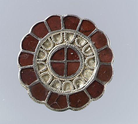 Brooch  Date: last quarter 6th century Culture: Frankish. Sun wheel in the center.