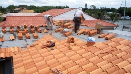 Roofers Installing Tile Shingle Roof On Florida Home Roof Installation Roof Cost Patio Roof
