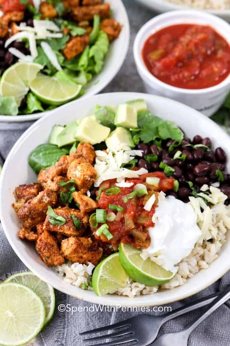 This one pot chicken burrito bowl is so easy to meal prep! Cook the chicken, rice and beans, then add toppings of your choice when you're ready to eat it. Salsa, sour cream, avocado, cilantro, the sky is the limit! #spendwithpennies #chickenburritobowl #maindish #chicken #burrito #onepot