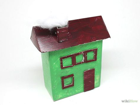 Build a Cardboard House - a step by step guide with videos.