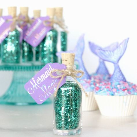 Deep under the frothy waves of the rolling sea, mermaids collect the shining, sparkling magic that can only be found on the ocean floor. Brilliantly marine teal and glittering like the sunrise on the lapping water, this magic will help you transform your next underwater birthday