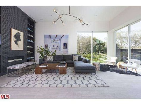 Innovative and modern decor. Bubble lighting, brick fireplace, floor to ceiling windows. Los Angeles, CA Coldwell Banker Residential Brokerage $4,250,000