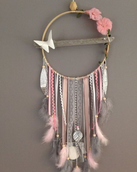 A sublime Dreamcatchers made entirely by hand from natural Driftwood from Lake Geneva and of Paris.  Finely worked and embellished with various feathers, accessories, wooden beads and ceramic. It has a fabric flower on the side, a butterfly made of origami and delicate rhinestones placed