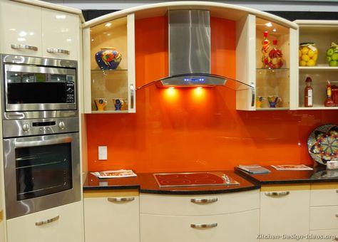 #Kitchen Idea of the Day: Modern Cream-Colored Kitchen with a orange glass backsplash!