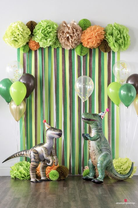 Dinosaurs may be extinct, but their timeless appeal continues to make dinosaur-themed birthday parties a roaring good time for anyone who digs the dino scene.Dinosaur Birthday Party Decorations for boys. In order to build up sense of ritual, celebrat Dinosaur Birthday Party, 4th Birthday Parties, Boys Birthday Decorations, Dinasour Birthday, 3 Year Old Birthday Party Boy, Diy Dinosaur Party Decorations, Birthday Celebration, 1st Birthday Party Ideas For Boys, Birthday Wall