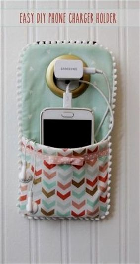 This DIY Phone Charger is so easy to sew up and makes such a cute holder for your phone while it's charging! | Find fun fabrics for your next project www.myfabricdesigns.com #DiyProjects