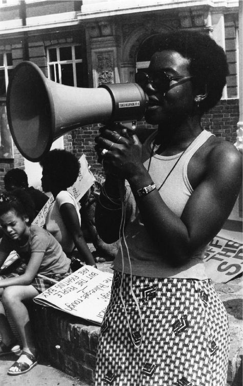 Olive Morris,member of the Brixton Black Panther Movement,speaking at a rally against police brutality outside Brixton Library (1972).   The UK Black Panther Movements developed from the work of the Universal Coloured Peoples Association. Although inspired by the ideology of the US Black Panthers,it was a different type of organisation that responded to the specific reality of Black people in the UK.It was short lived,& its main period of activity was from 1970-73.