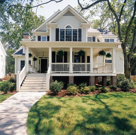 Obsessed with this house by Frank Betz Associates. Love the front porch and the hanging plants!