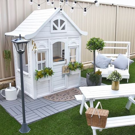 how she turned a basic cubby house from Kmart into a Hamptons-style playhouse for her two children. The post how she turned a basic cubby house from Kmart into a Hamptons-style playhouse for her two children. appeared first on Children's Room. Kids Cubby Houses, Kids Cubbies, Play Houses, Backyard Playhouse, Build A Playhouse, Backyard Playground, Painted Playhouse, Girls Playhouse, Kids Outside Playhouse