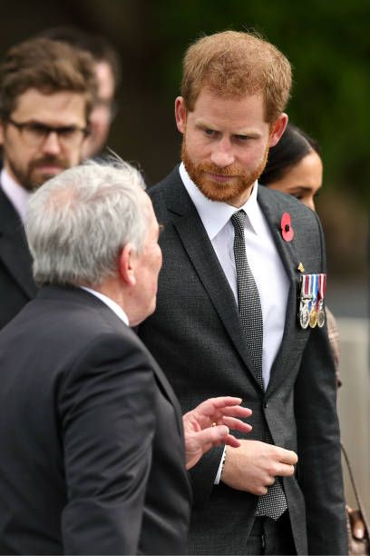 prince harry duke of sussex looks on during a wreath laying ceremony prince harry photos prince harry prince harry and meghan pinterest
