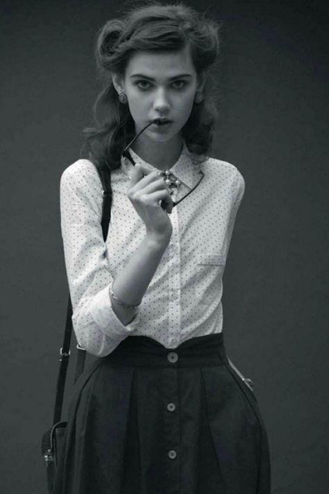 I love this entire look. Her blouse, her skirt, her hair, her handbag...Angela