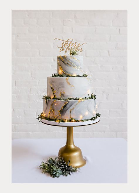 Wedding Cakes : Picture Description Gold Leaf Accented Marble Wedding Cake with Fairy Lights ~ pretty awesome cake by Nutmeg Cake Design